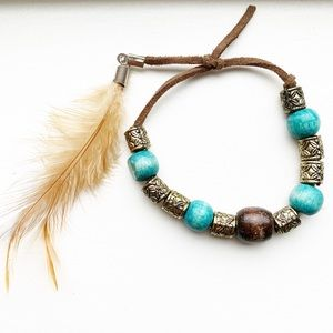 Boho brown suede & wood bead feather bracelet